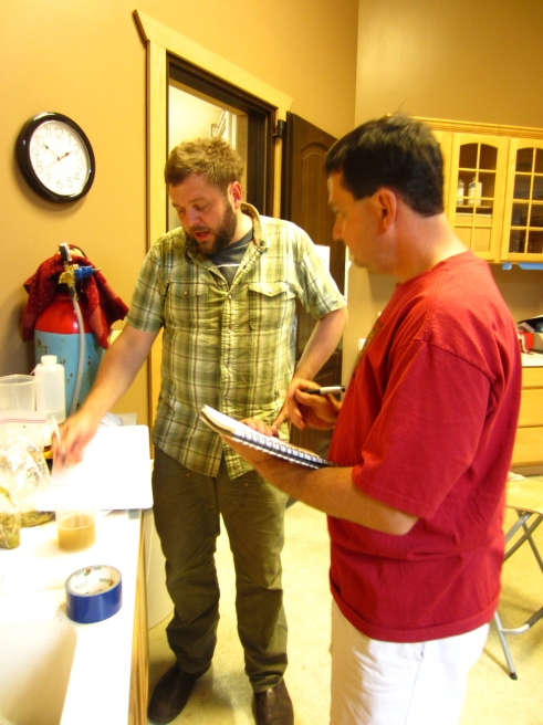 Drew and Dave run the ph numbers to check the acidity of the pinot juice.