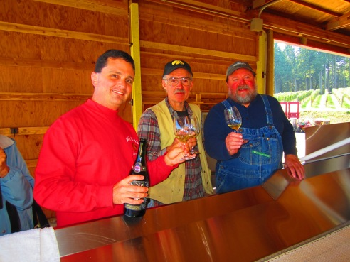 Dave, Fred Robinson of Robinson Family Vineyard (our source for Pommard clone pinot noir), and Dean Fisher of ADEA Wine Company toast the processing of Fred's grapes--the first down the line.