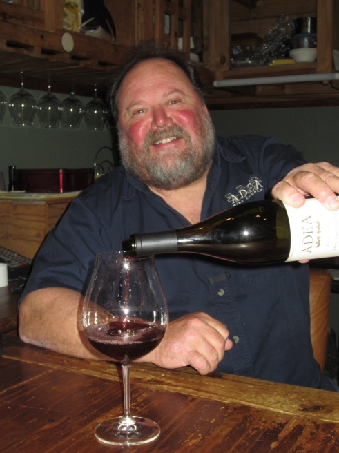 Dean Fisher pours a glass of Deano's Pinot in his tasting room at ADEA Wine Company.