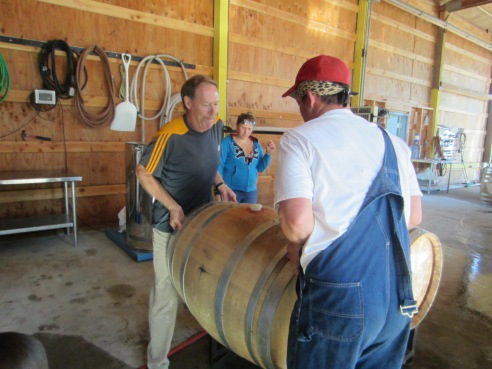 Under Erica's supervision, Steve and Jake get one of our barrels prepped for filling.
