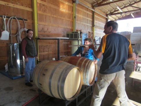 Getting ready to insert the filling tube into one of the barrels.