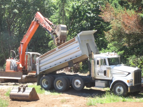 Step 3: Make sure the CMO takes pictures of boulder placement in dump truck from multiple angles.