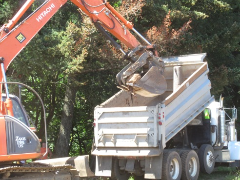 Step 2: Place boulder in dump truck.