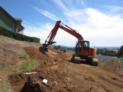 Backfilling the trenches.